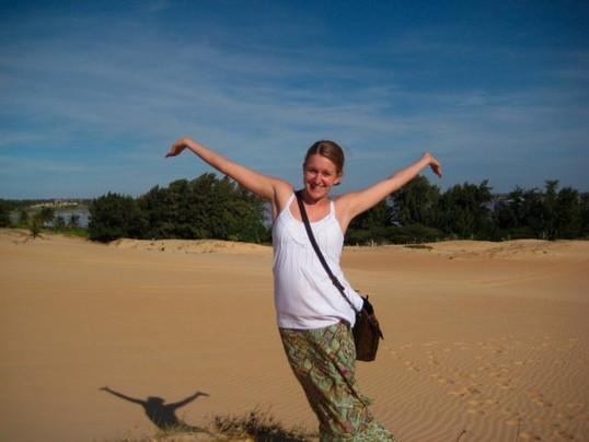 Katie enjoying the sunshine in the desert near Lac Rose