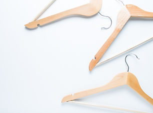 Wooden hanger on white background.jpg