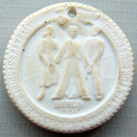 Medalha de porcelana branca (1951). III Festival Mundial da Juventude