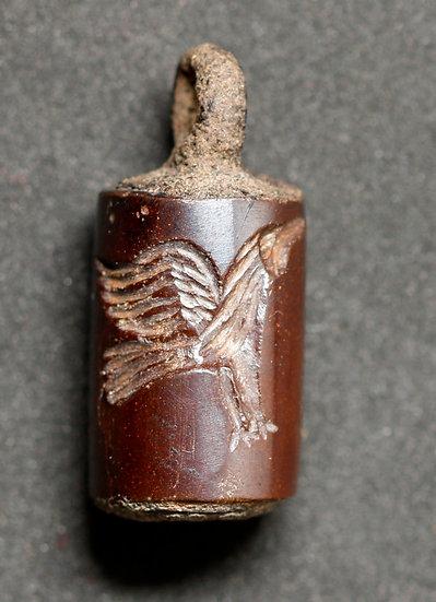 Selo cilíndrico de pedra do Oriente próximo, possivelmente persa-aquemênida (cir