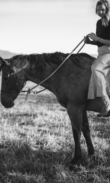 western girl riding horse in Montana mountains