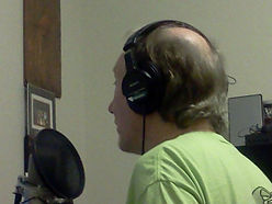 "Randy Brooks, songwriter of ""Grandma Got Run Over by a Reindeer,"" in the studio"