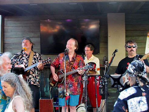 The Sand Band at Treasure Island, Port Aransas, Texas.  Left to right: Kelly Brown, Randy Brooks, Alan White, Mike Eiras