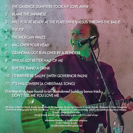 "Back cover and song listing for Randy Brooks' Greatest Hit CD, including ""Grandma Got Run Over by a Reindeer"""
