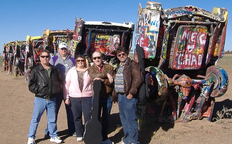 Trop-pop band the Bad Monkeys at the Cadillac graveyard outside Amarillo.  From left: Louie Chambers, Zach Rhodes, Sharon Oefinger, Randy Brooks, Kelly Brown