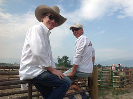 Singer/songwriters Randy Brooks and Rod Phillips watching a roundup in the Bitterroot Valley, Montana