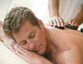 Warm lava stone massage for him