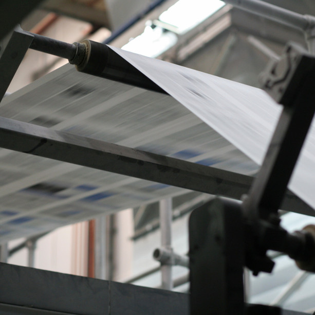 Interviews and Features link with a picture of a Printing Machine