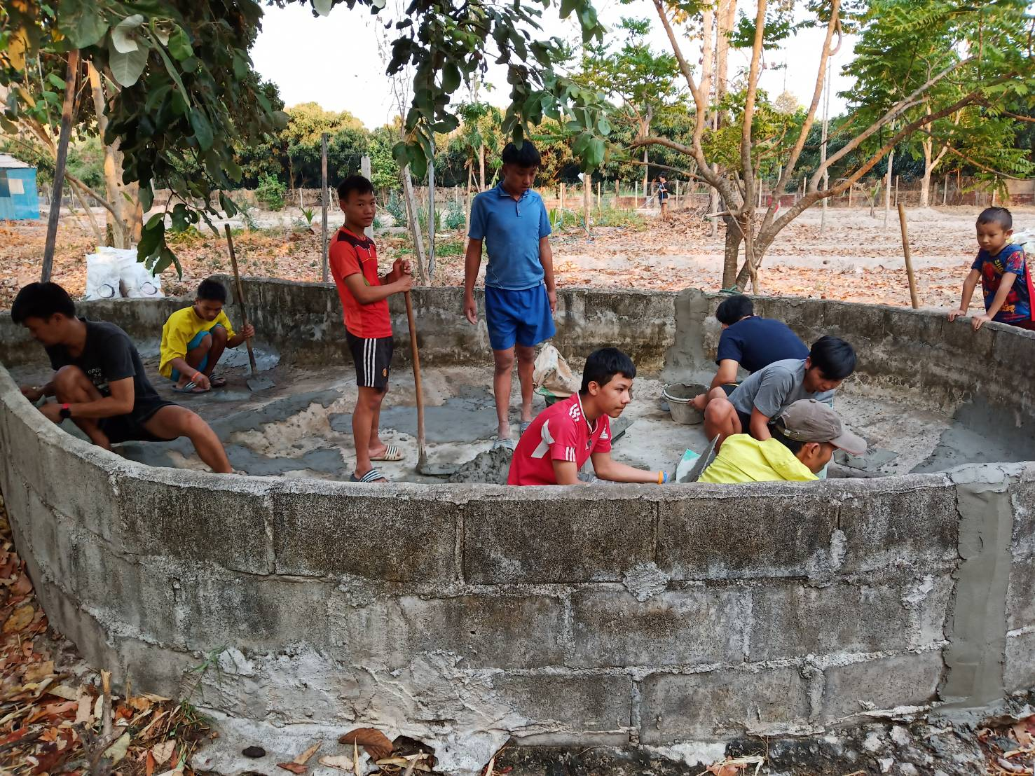 Re-cementing our Fish Pond