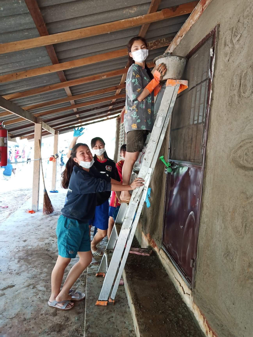 Repainting the Clay house with our Taiwanese volunteer friends