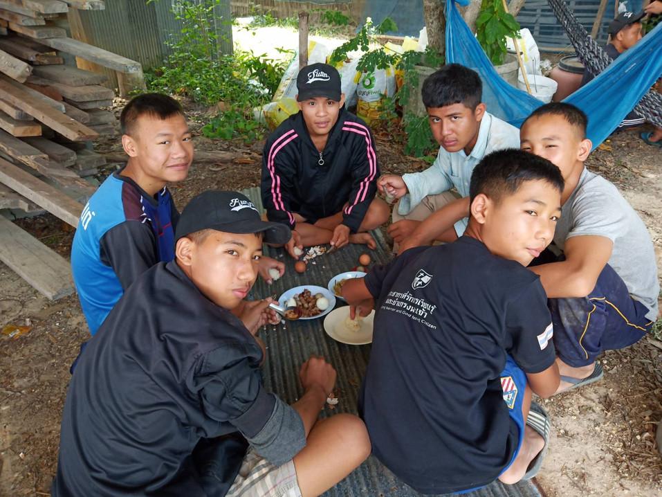 Hungry boys enjoying their meal