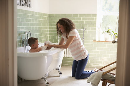 Mother And Son Having Fun At Bath Time T