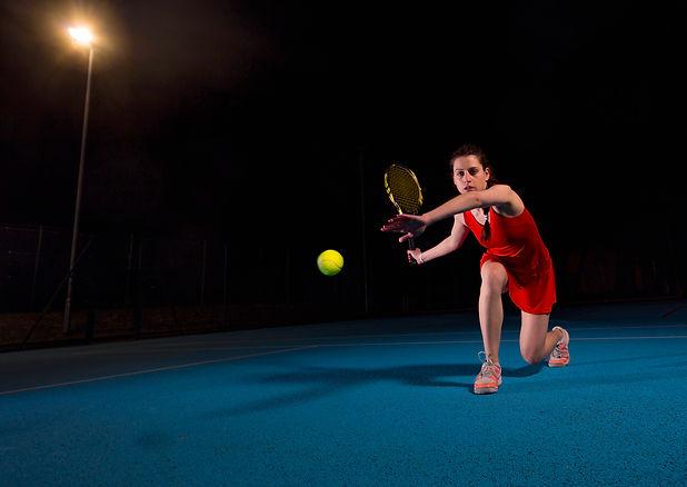 Tennis player at night IWE sports lighting.jpg
