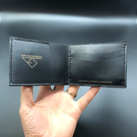 Black Leather Wallet in Hand