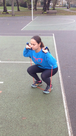 Squats using resistance bands
