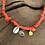Thumbnail: Collier orange fluo coquillage oeil jaune
