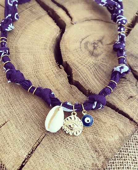 Collier violet coquillage oeil