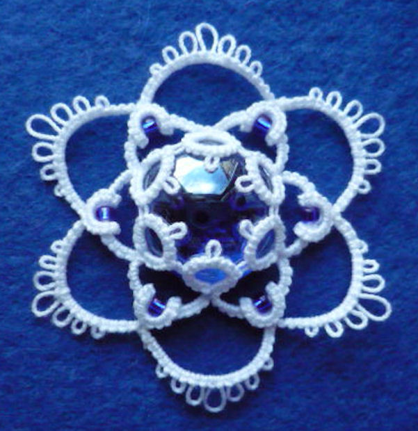 Ice Drop Medallion with curled rings.jpg