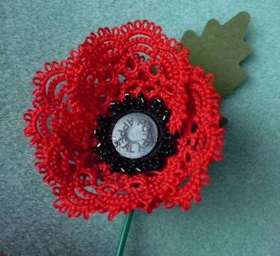 Poppy with British Legion button and lea
