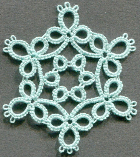 Medallion with rings off chains.jpg