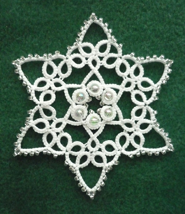 Snowflake using small and large beads.jp