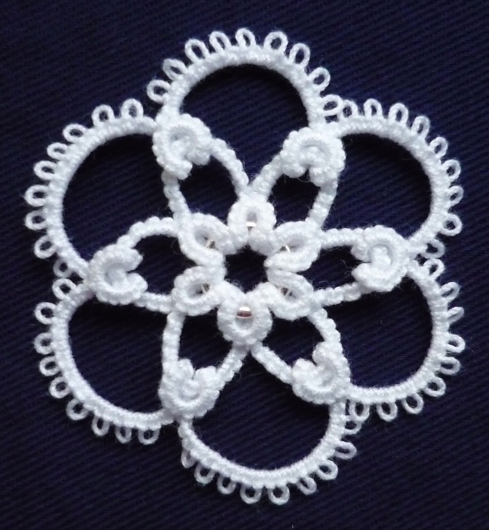 Another Medallion using curled rings.JPG