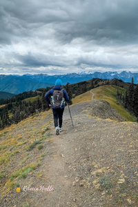 Hiking in Olympic National Park with my pack and trekking pole.