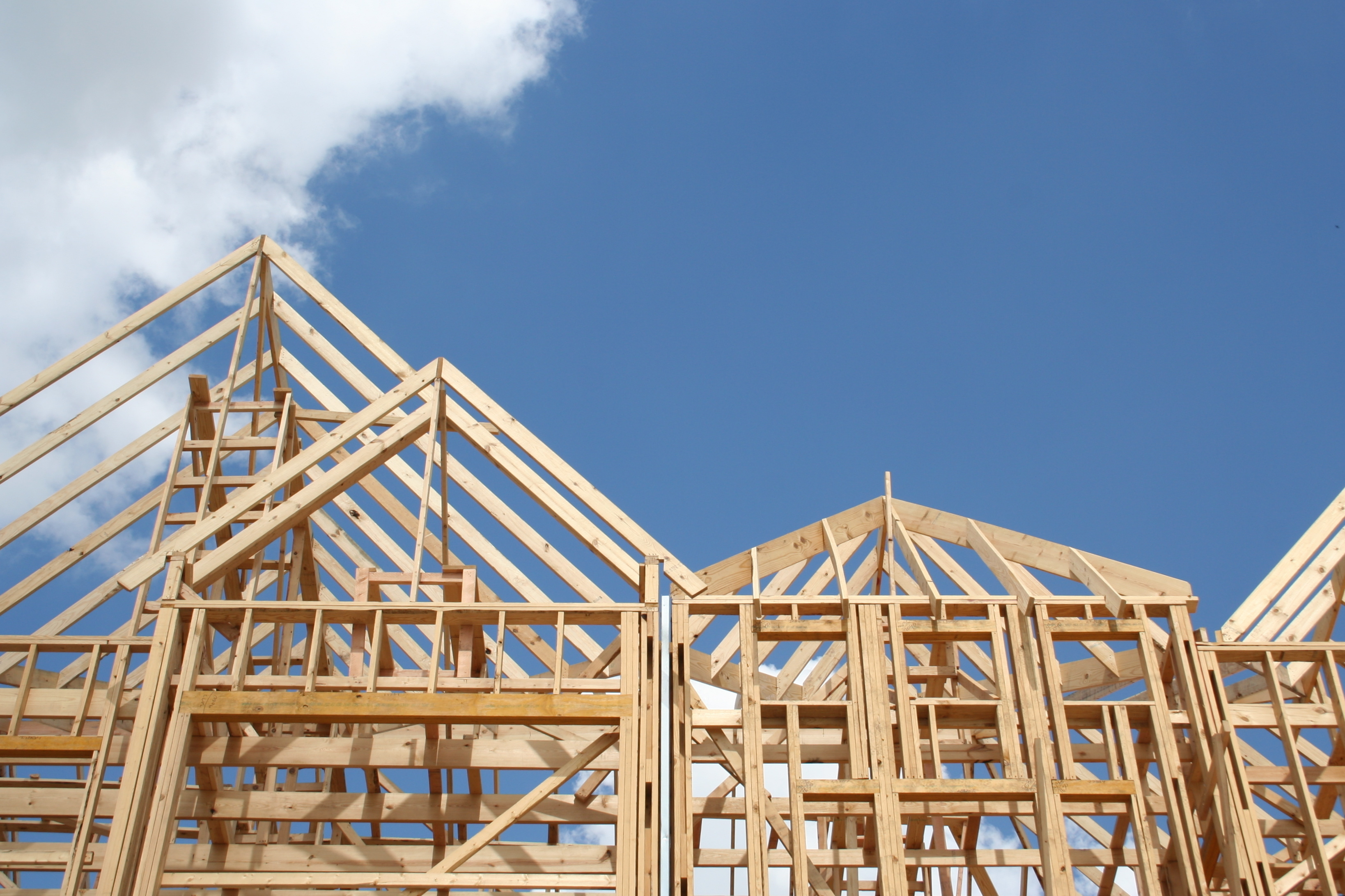 bigstock-Frame-of-a-new-home-26157017