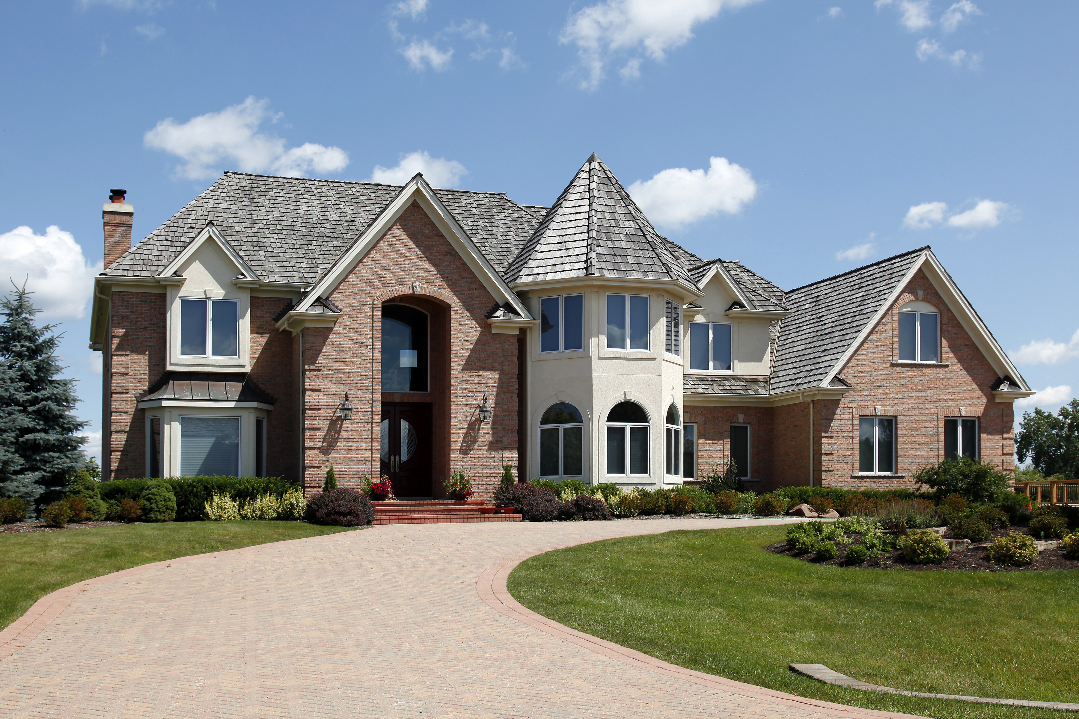 bigstock-Large-home-in-suburbs-with-tur-18131399