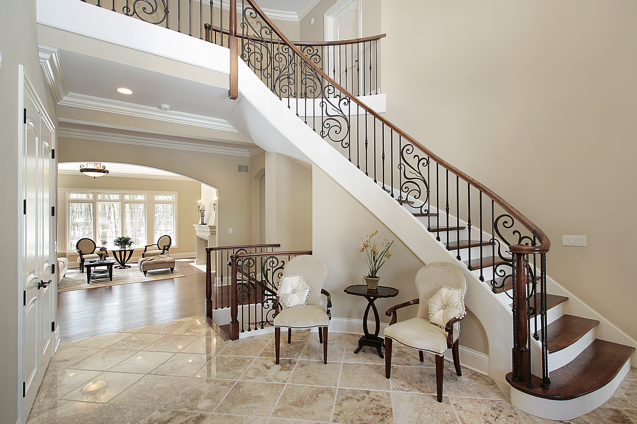 bigstock-Foyer-With-Curved-Staircase-5268783