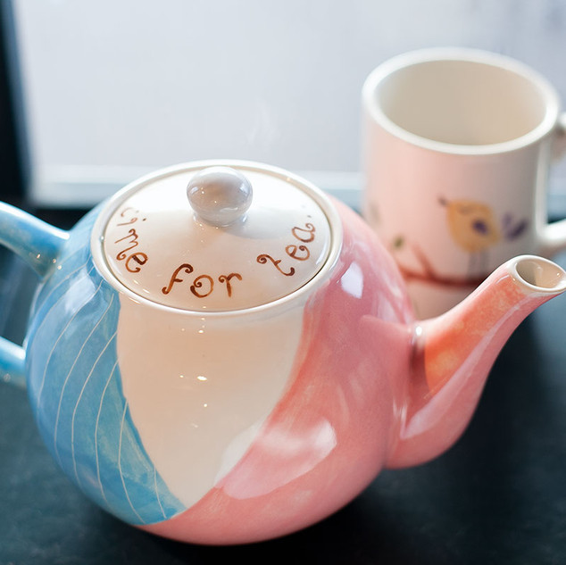 Hand painted teapot and mug at Creative Bisucit Ceramics Cafe in South Woodford, east London