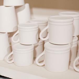 Ceramic mugs at Creative Biscuit Ceramics Cafe