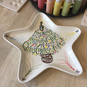 Christmas star plate painted at Creative Biscuit Ceramics Cafe