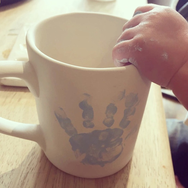 Handprints on pottery at Creative Biscuit Ceramics Cafe London
