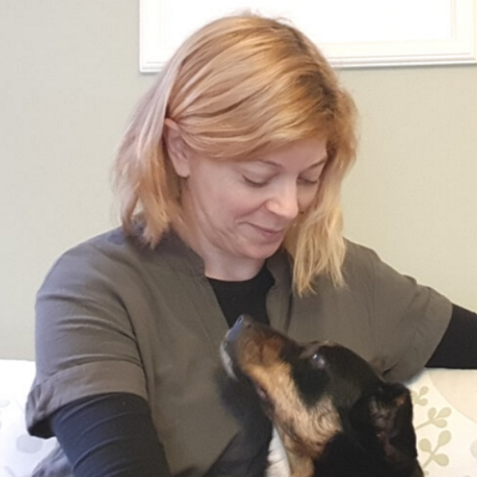 Sophie Shaw hypnotherapist and Reiki Master and her rescue dog, Ellie
