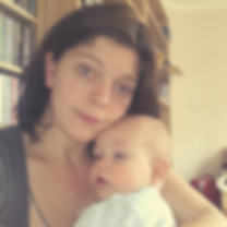 Sophie Shaw hypnotherapist and Reiki Master holding her baby son