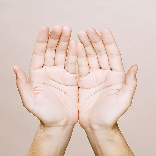 A pair of hands, palms together for reiki self-healing