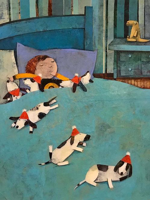 7 chiots sur un lit