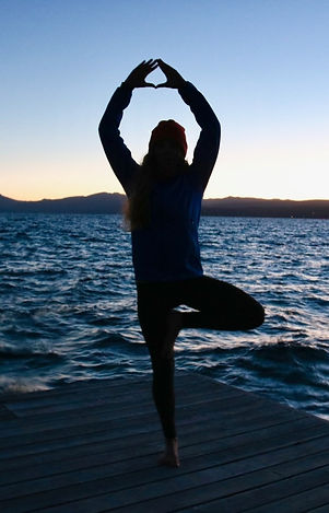 Girl doing yoga on dock.jpg