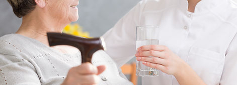 glass-of-water-for-elderly-woman-P9JLVEP