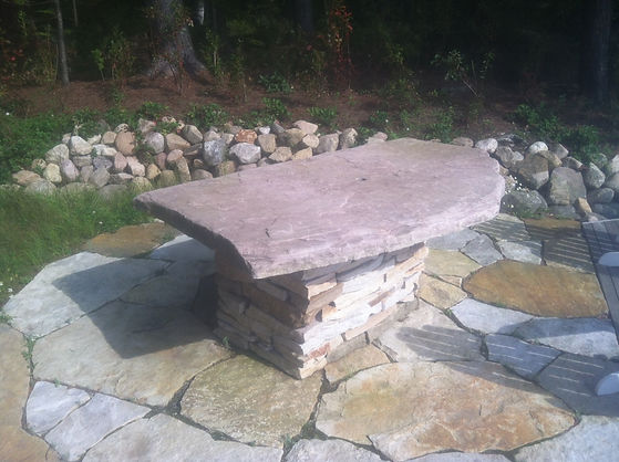Lands End stone table and patio.JPG