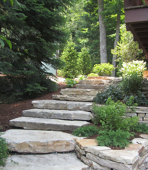 4. Stone steps with terraced planters re