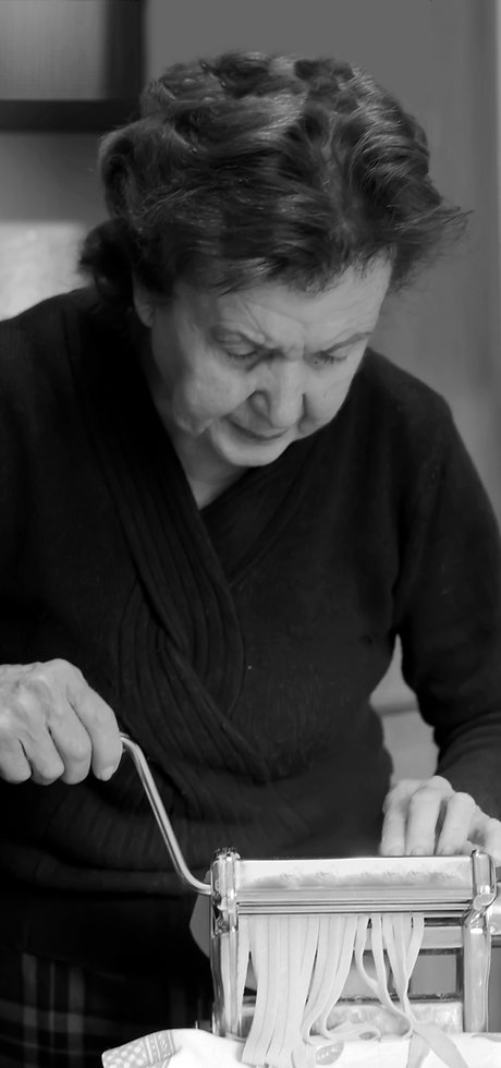 Elderly Woman Making Pasta