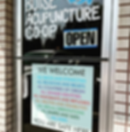 Boise Acupunture Co-op front door with a sign weloming diversity