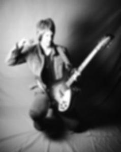 River Lynch playing a rickenbacker electric guitar