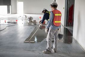 Construction worker painting epoxy floor
