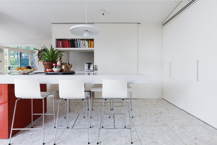 Clean crisp white modern kitchen island