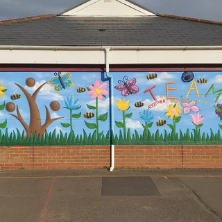 Quote and School Logo Exterior Hand Painted Mural