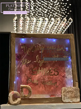 Shadowbox birthday cake covered in fondant, modeling chocolate, and edible glass with LED lights.      Created by Platunum Cake Designs in our Decatur, Ga studio.  Making Memories Sweeter #platinumcakedesigns #decatur #fondant #edibleglass #shadowbox #inspirational #pink #gold #birthdaycake #inspirational