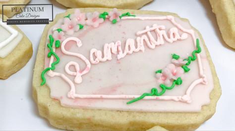 Closeup:  Baby shower cookies for an expectant mother and her baby girl.  #sugarcookies #babygirl #babyshower #decatur #atlanta #sugarflowers #makingmemoriessweeter #platinumcakedesigns